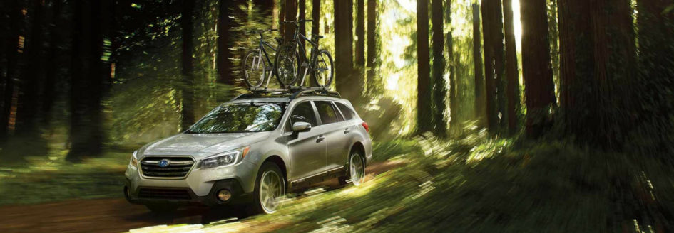 2019 Subaru Outback driving through forest