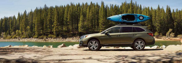 Green 2019 Subaru Outback parked lakeside