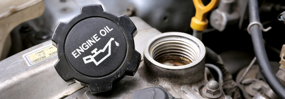 Oil cap laying on top of engine
