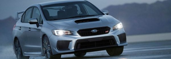 2019 Subaru WRX driving around a curve in the road